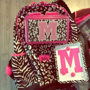 Backpack, pencil box and magnet board